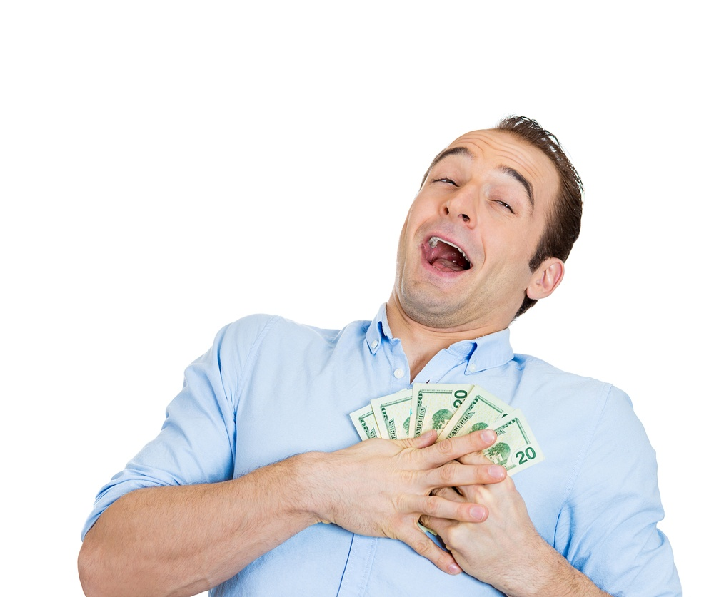 Closeup portrait of super happy excited successful business man, funny looking guy holding money dollar bills in hand, isolated on white background. Positive human emotions, facial expression feeling..jpeg